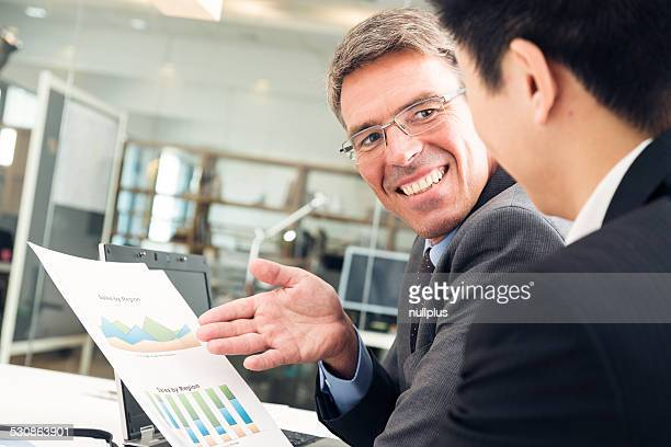 entrepreneur talking to potential investor for his new business