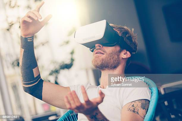 Entrepreneur testing virtual reality technology