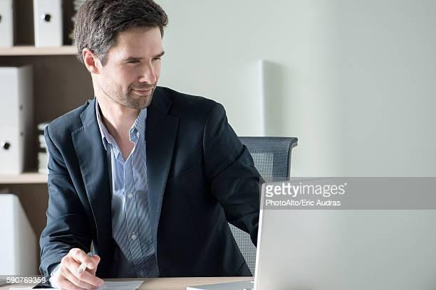 Entrepreneur using laptop