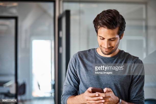 Entrepreneur using mobile phone at office