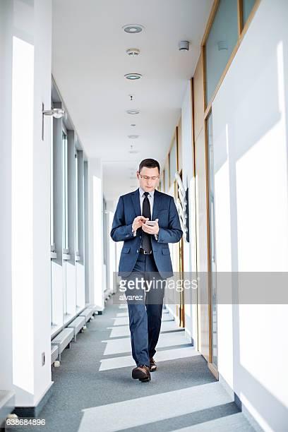 Entrepreneur using smart phone in office