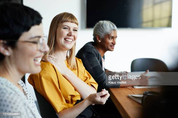 entrepreneur with coworker in office meeting - employee engagement stock pictures, royalty-free photos & images