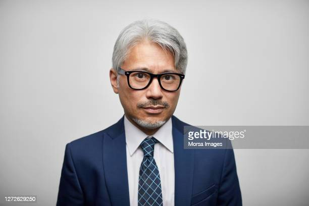 entrepreneur with eyeglasses on white background - grey suit stock pictures, royalty-free photos & images