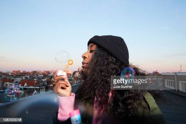 Woman blows bubbles