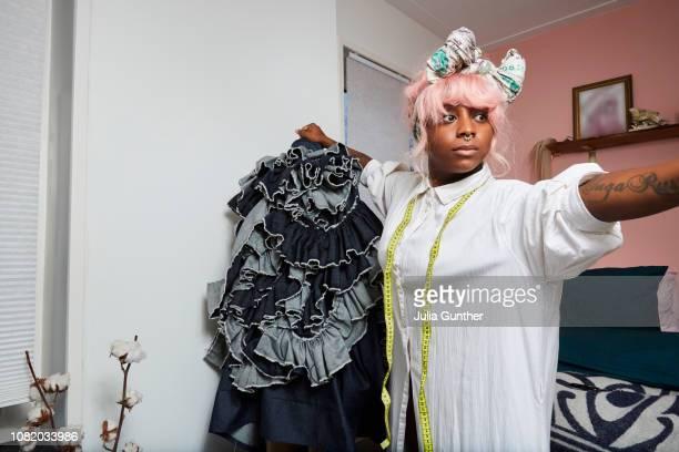 woman fixes a coat - showus stockfoto's en -beelden