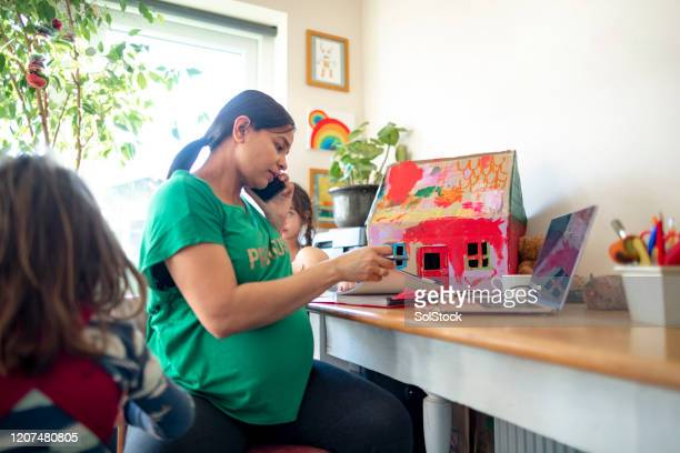 entrepreneurial motherhood - femalefocuscollection stock pictures, royalty-free photos & images