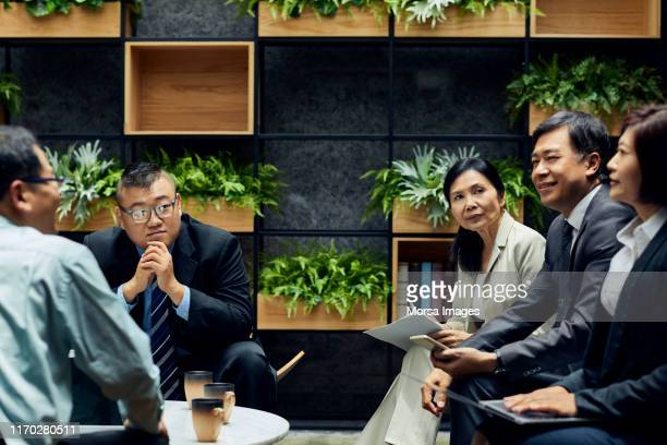 entrepreneurs discussing strategy in office - taiwan stock pictures, royalty-free photos & images