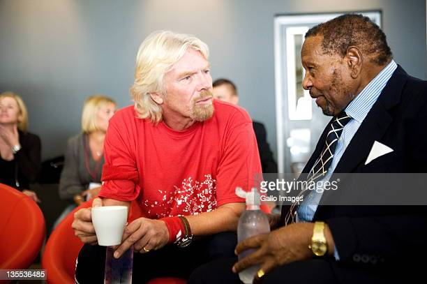 Entrepreneurs Sir Richard Branson and Richard Maponya attend the grand opening of Maponya Mall's Virgin Active on December 10 2011 in Soweto South...