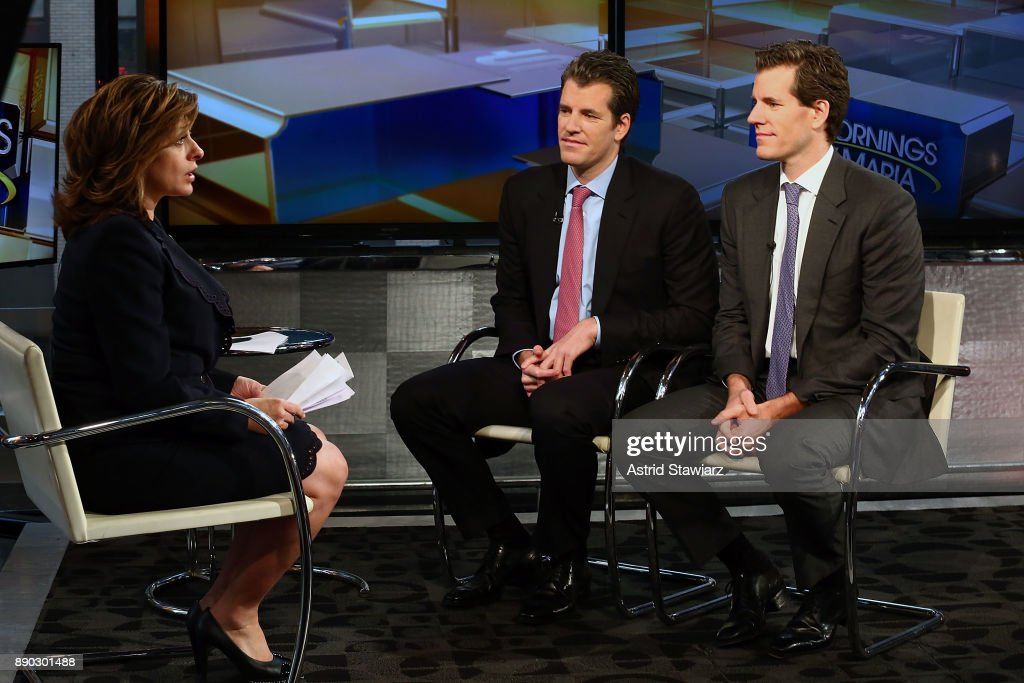 Entrepreneurs Tyler Winklevoss and Cameron Winklevoss (R) discuss bitcoin with with Maria Bartiromo (L) during FOX Business' 'Mornings With Maria' at FOX Studios on December 11, 2017 in New York City.