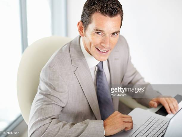 entreprenuer  sitting at laptop - number of people stock photos and pictures