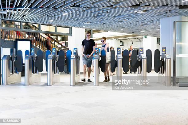 Entry gates in modern underground Wynyard train station, Sydney Australia