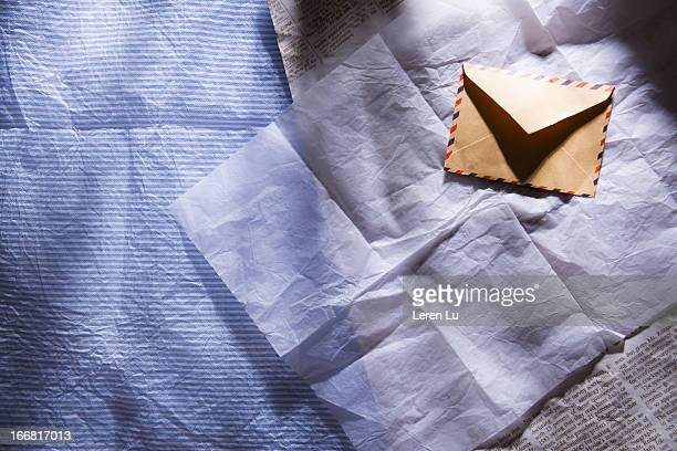 envelope and sunshine on the table - leren stock pictures, royalty-free photos & images