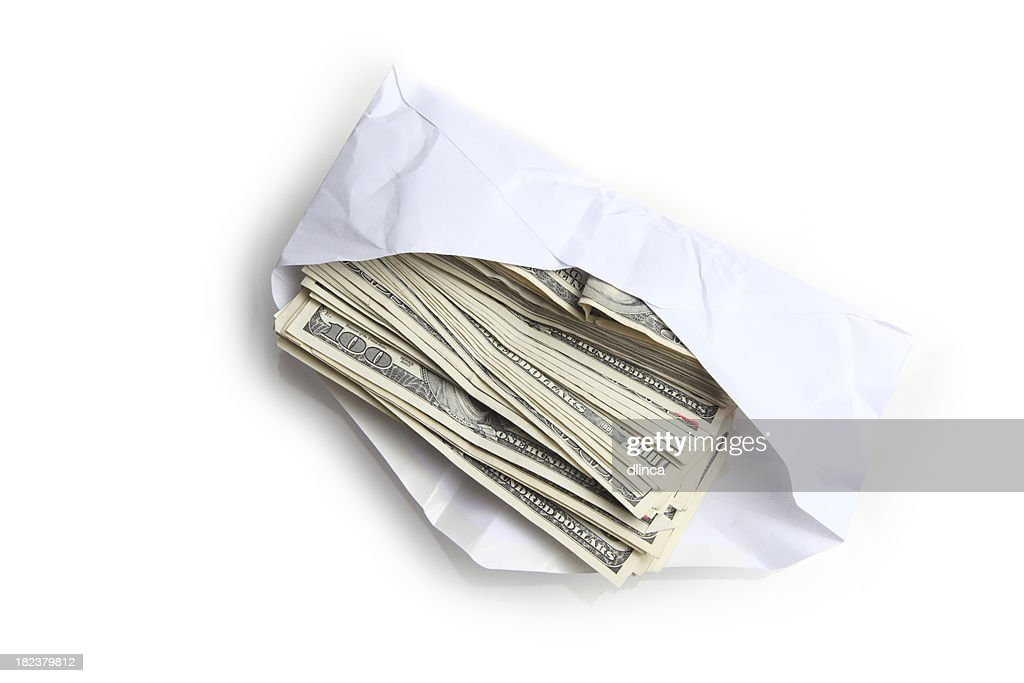 Envelope filled with stack of hundred dollar bills : Stock Photo