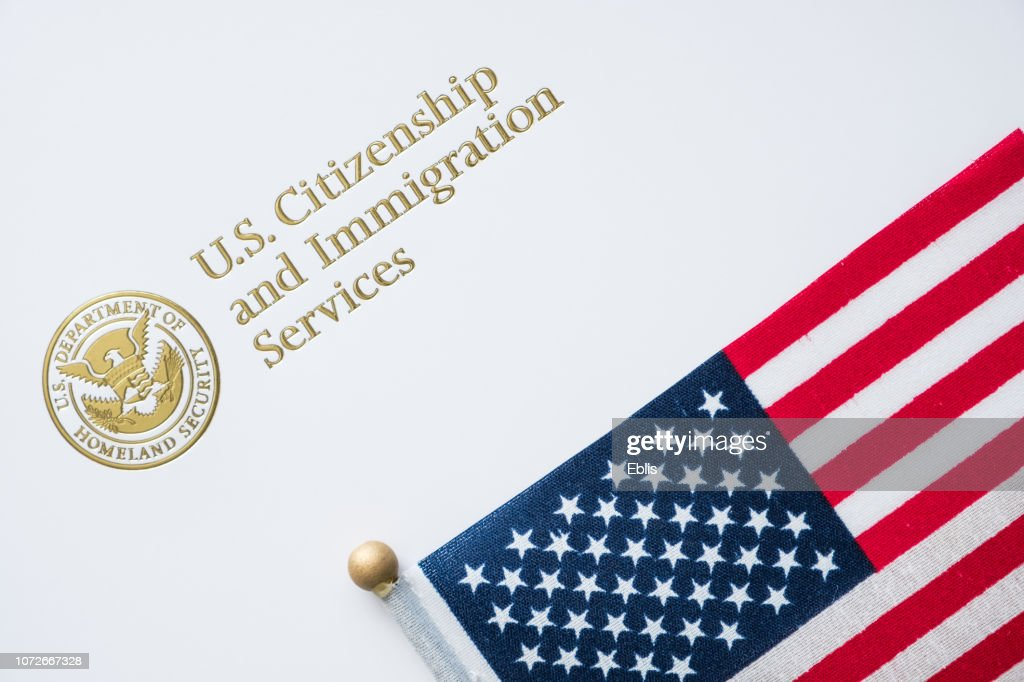 Envelope from U.S. Citizenship and Immigration Services with the American flag on top/U.S. immigration concept : Stock Photo