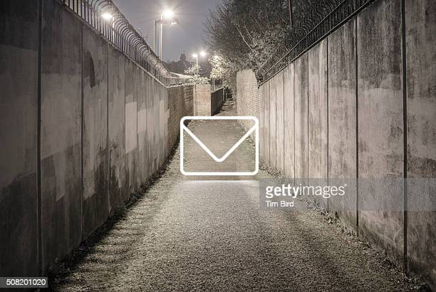 Envelope icon in alley at night