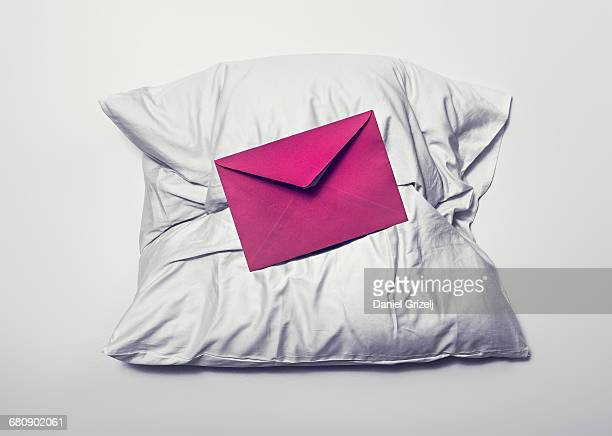 envelope on a pillow