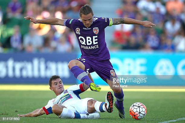 Enver Alivodic of the Jets challenges Josh Risdon of the Glory during the round 22 ALeague match between the Perth Glory and the Newcastle Jets at...