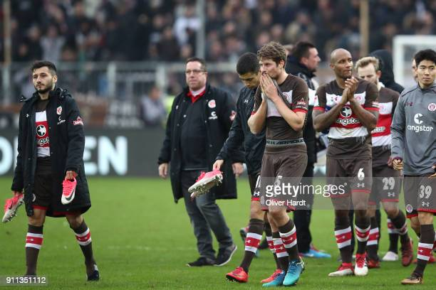 Enver Cenk SahinyMarkus KauczinskiDaniel Buballa and Christopher Avevor of Pauli appears frustrated after the Second Bundesliga match between FC St...