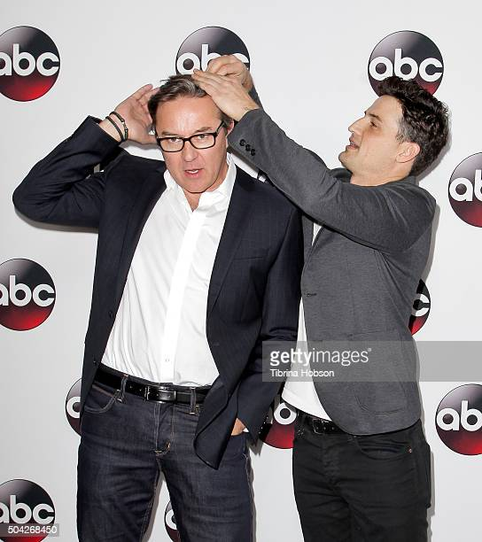 Enver Gjokaj helps Currie Graham with his hair at the Disney/ABC 2016 Winter TCA Tour at Langham Hotel on January 9 2016 in Pasadena California