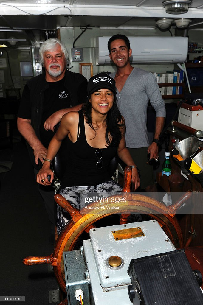Enviornmental activist Paul Watson, Michelle Rodriguez and Hamza Talhouni are seen as they visit The Sea Shepard's Steve Irwin Vessel during The 64th Annual Cannes Film Festival on May 20, 2011 in Cannes Harbor, France.