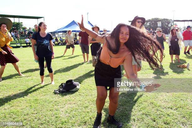 Environment activists dance during a rally at the Clermont Showground in protest against the proposed Adani coal mine on April 28 2019 in Clermont...