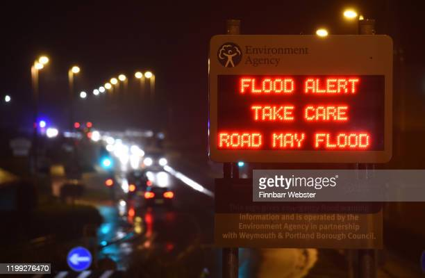 Environment Agency flood alert warning sign on the A354 road as Storm Brendan heads in on January 13, 2020 in Weymouth, United Kingdom.