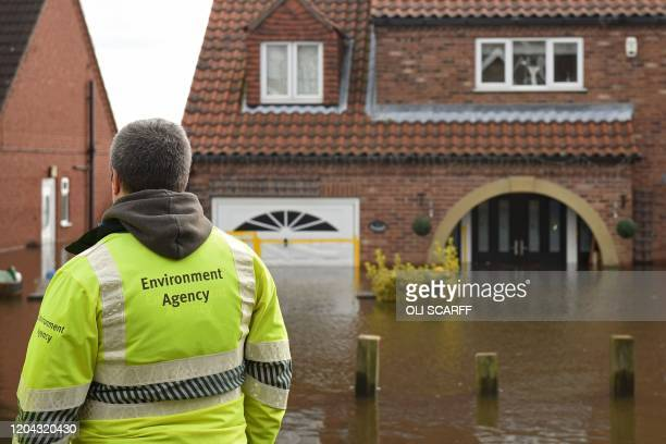 Environment Agency staff check on the rising floodwaters in East Cowick northern England on March 1 2020 after Storm Jorge brought more rain and...