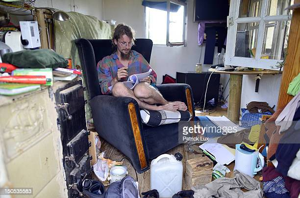 Environment engineering student Robert reads in his home at Wagenburg Fango on August 20 2012 in Lueneburg Germany Around 30 people live in the...