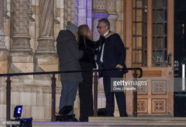 Environment Secretary Michael Gove hugs Carrie Symonds as he leaves the Conservative party Black and White Ball at Natural History Museum on February...