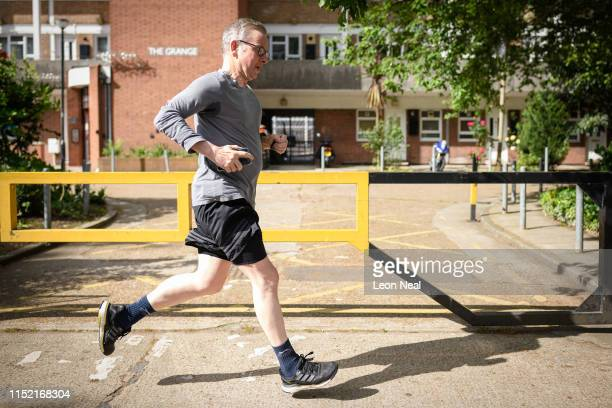 Environment Secretary Michael Gove returns to his home after a jog on May 28 2019 in London England Gove has recently announced his bid to become the...