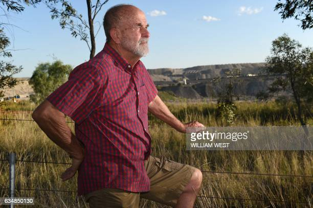 Environmental activist John Krey from the small Australian village of Bulga looks out over a coal mine in the Hunter Valley on November 18 2015 AFP...