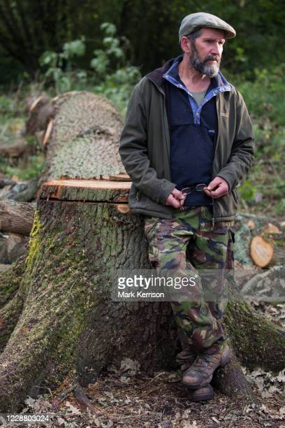 Environmental activist Mark Keir stands in front of a mature oak tree felled by tree surgeons working on behalf of HS2 Ltd in Denham Country Park for...