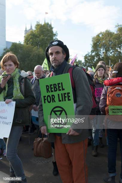 Environmental activist seen holding a placard during the protest The newly formed Extinction Rebellion group concerned about climate change calls for...