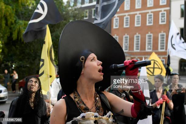S SQUARE LONDON GREATER LONDON UNITED KINGDOM Environmental activist speaks while holding a microphone during a protest in London Extinction...