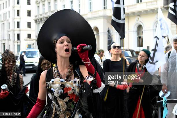 S SQUARE LONDON GREATER LONDON UNITED KINGDOM Environmental activist speaks while holding a microphone outside Repsol headquarters during a protest...