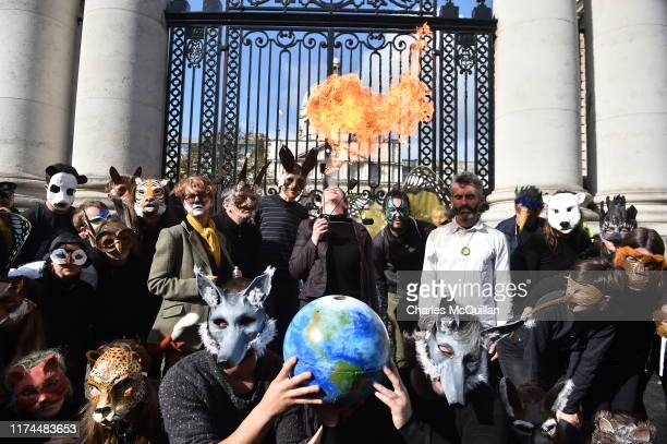 Environmental activists affiliated wtih Extinction Rebellion protest outside Government Buildings as Finance Minister Paschal Donohoe unveils the...