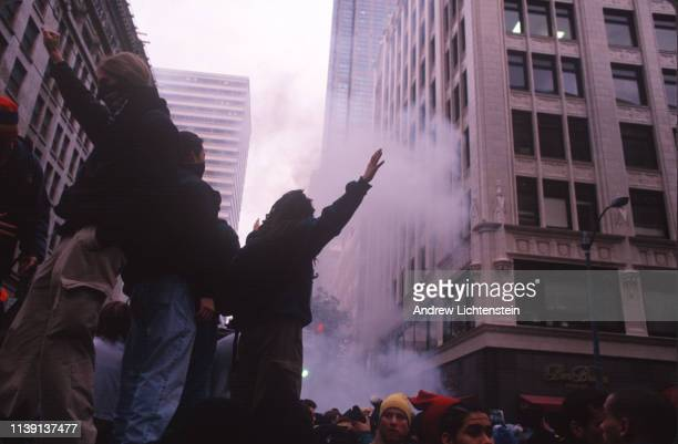 Environmental activists and police clash on the streets as protestors attempt to block delegates of the World Trade Organization from attending an...