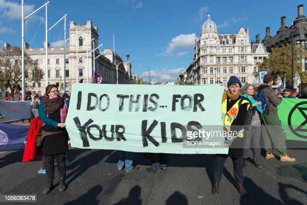 Environmental activists are seen holding a banner during the protest The newly formed Extinction Rebellion group concerned about climate change calls...