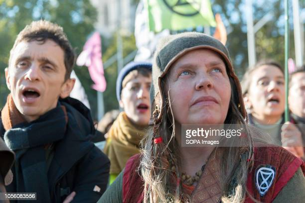 Environmental activists are seen singing during the protest The newly formed Extinction Rebellion group concerned about climate change calls for a...