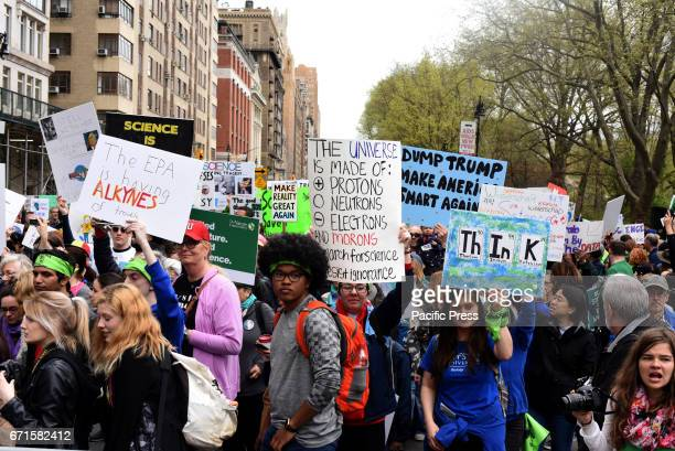 Environmental activists attend the march for science in Manhattan on Earth Day About three dozen activists marched around New York's Central Park...
