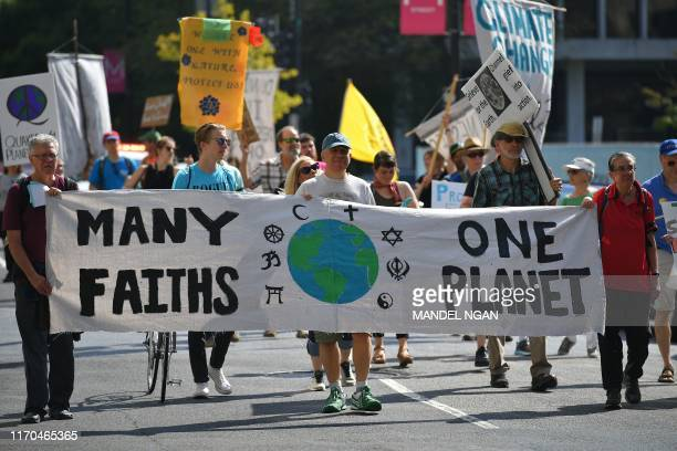 Environmental activists block an intersection as they gather to protest to shut down the city during global climate action week on September 23 2019...