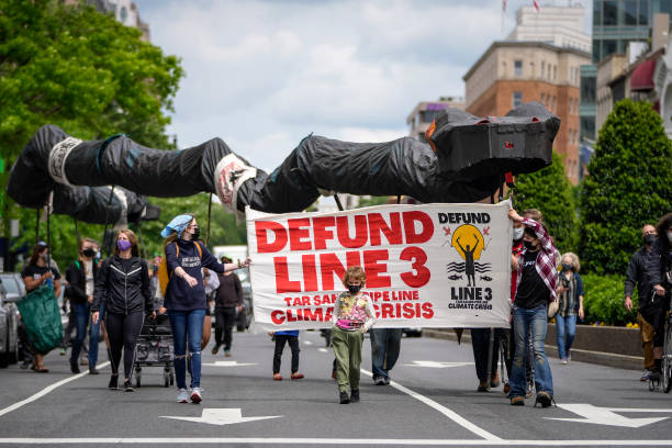 DC: Environmental Activists Protest Wells Fargo's Funding Of Oil Pipelines