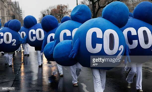 Environmental activists dressed up as CO2 molecules stage a protest in Berlin on December 12 2009 to coincide with the United Nations Climate Change...