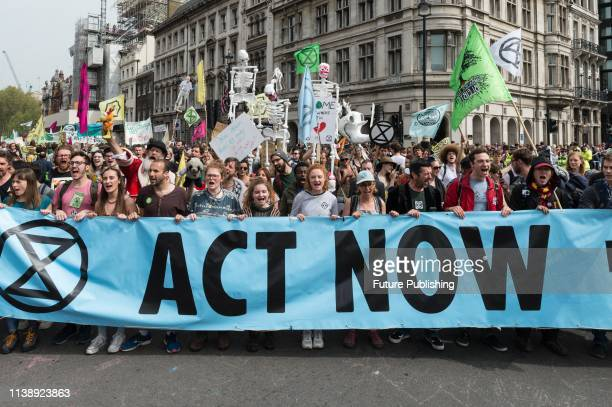 Environmental activists from Extinction Rebellion march to Parliament Square on the ninth day of protest action aiming to invite MPs to take part in...
