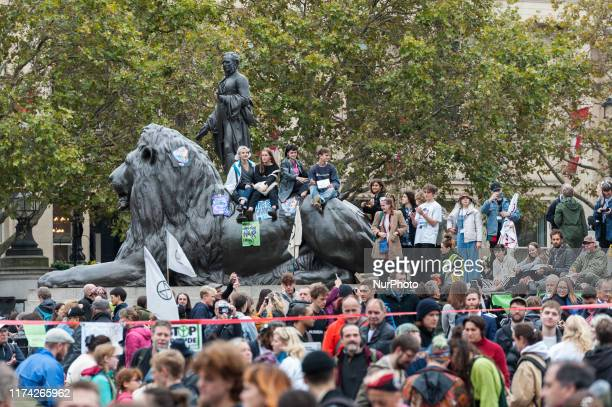 Environmental activists from Extinction Rebellion protest in Trafalgar Square on 07 October, 2019 in London, England. The protesters plan to blockade...