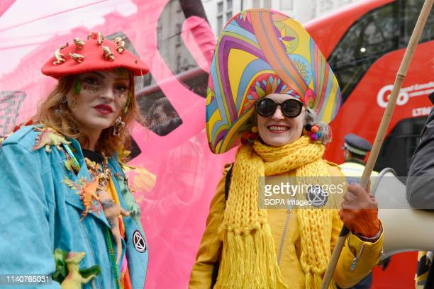 Environmental activists from Extinction Rebellion rally outside the Embassy of Brazil in London during the XR Carnival of Chaos Extinction Rebellion...