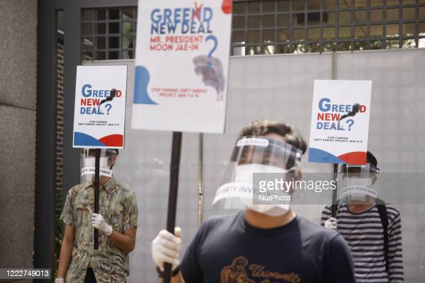 Environmental activists implement health protocols during conduct an AntiDirty Energy rally in front of South Korean Embassy in Jakarta on June 25...