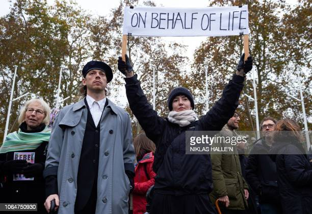 Environmental activists march during a demonstration organised by the movement Extinction Rebellion in central London on November 24 calling on the...