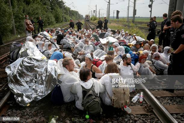 Environmental activists occupy the railroad tracks accessing to the brown coal power plant in Neurath near Grevenbroich western Germany on August 25...