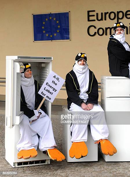 Environmental activists of 'Friends of Earth Europe' dressed as penguins set up a mock penguin refugee camp made of refrigerators to demonstrate on...